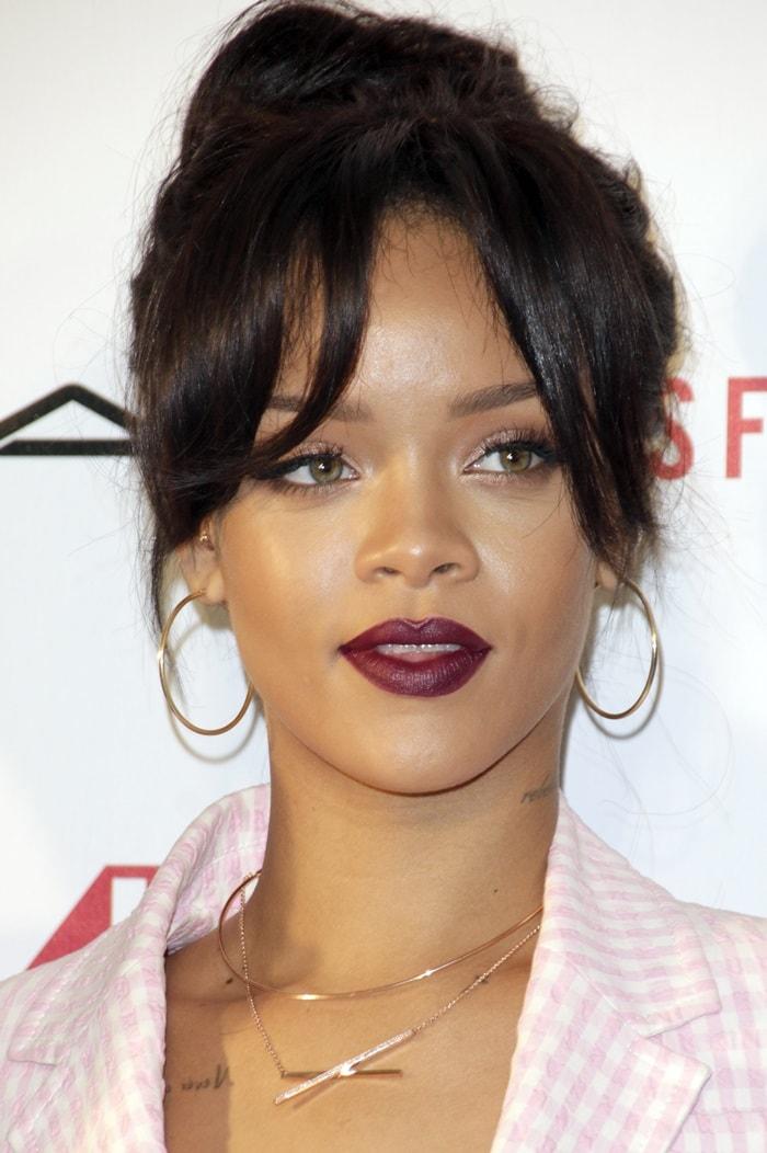 Rihanna wearing huge hoop earrings