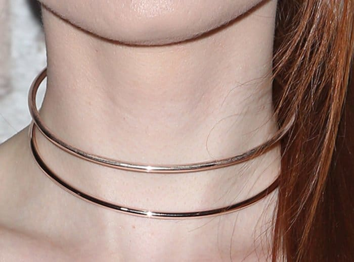 Madelaine Petsch's double layer of rose gold chokers decorated her neck
