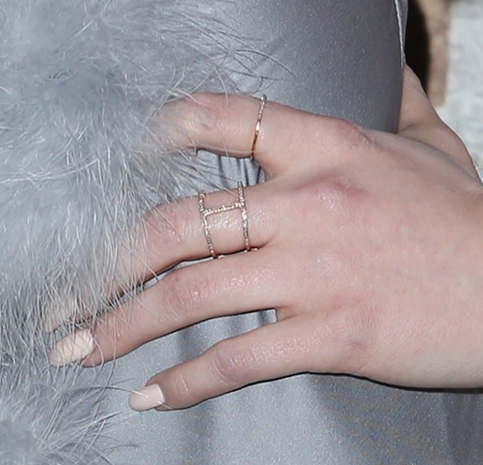 Madelaine Petsch's thin band rings and a rose gold Cartier ring band