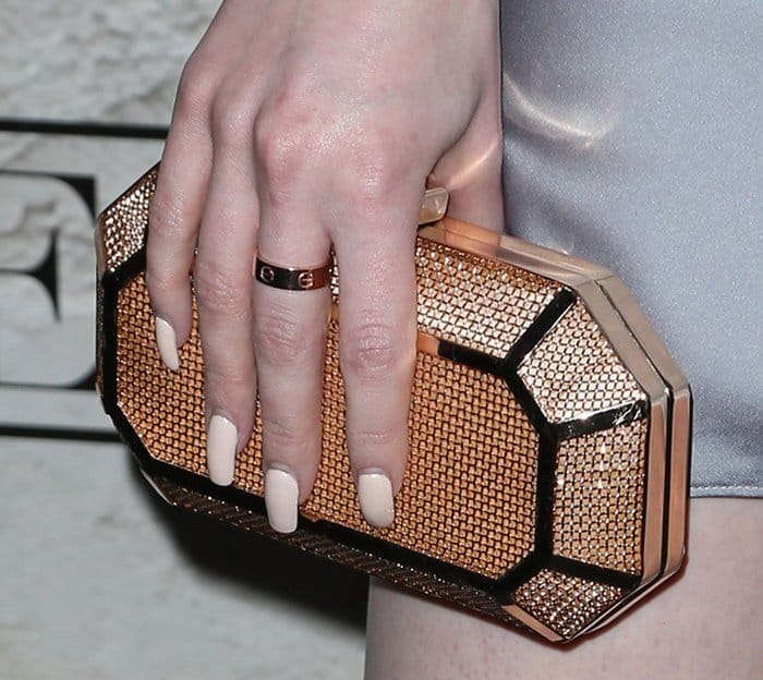 Madelaine Petsch toted a glittering metallic clutch