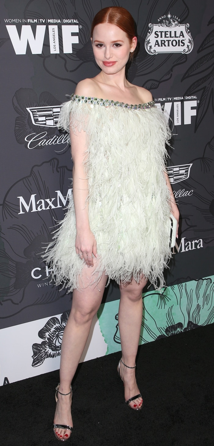 Madelaine Petsch flashed her legs in a short light green feather dress