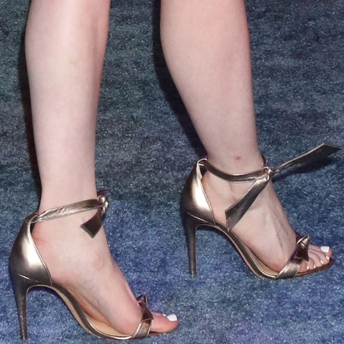 Madelaine Petsch's pretty feet in high stiletto heels