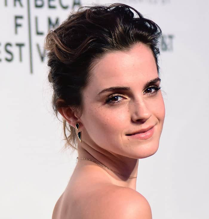 Emma Watson kept her hair up to show off her neck and shoulders