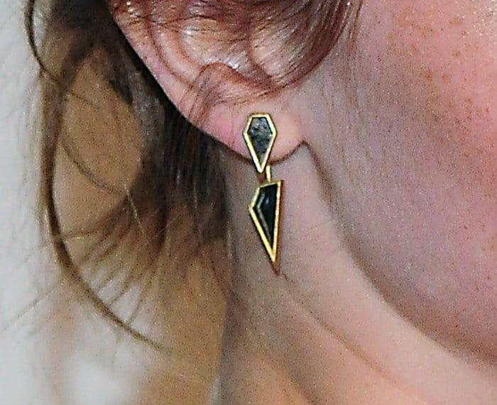 Emma Watson wearing unique Monique Péan Fossilized Dinosaur Bone earrings