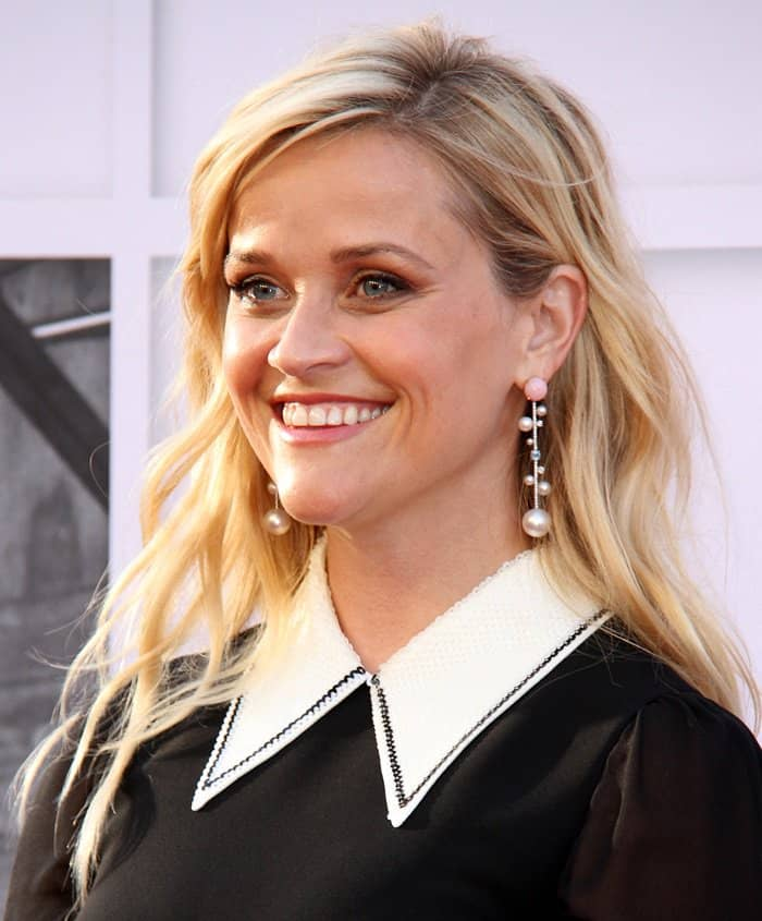 Reese walked in with a big smile as she posed on the red carpet
