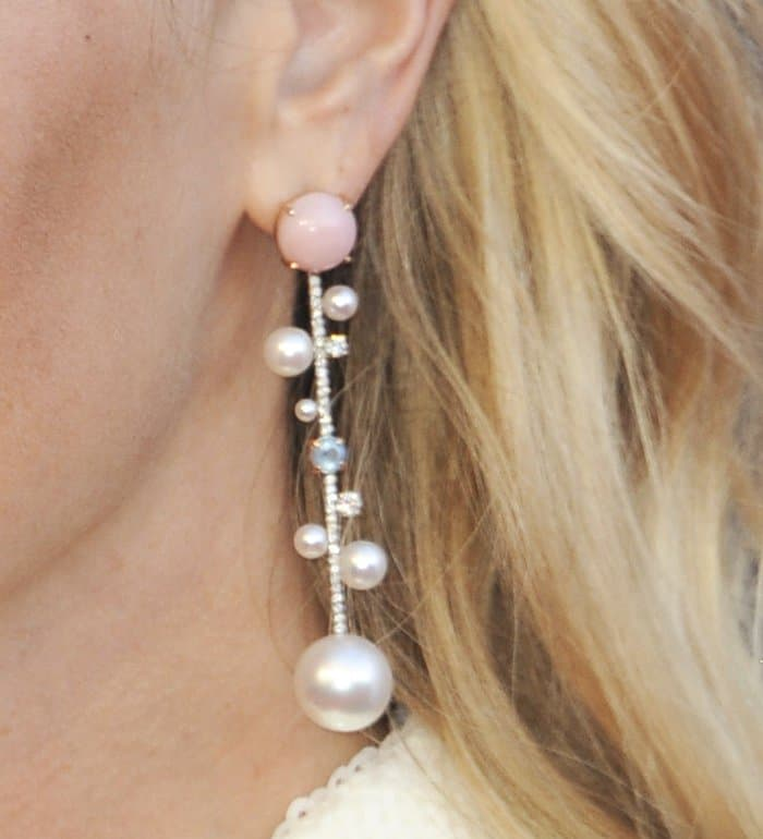 Pink and blue stones add a touch of fun detailing to the pearl earrings