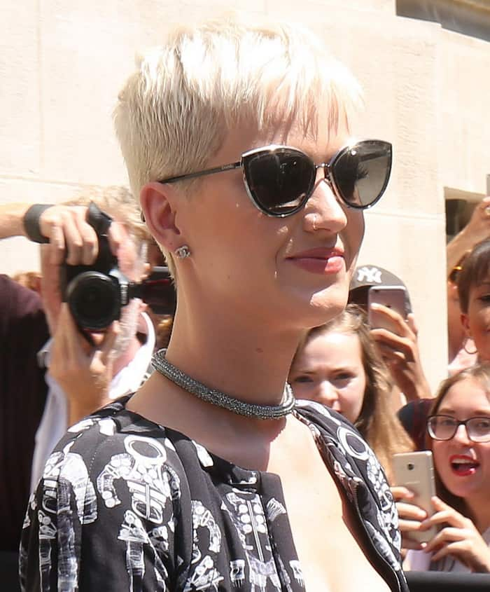 Katy Perry wore beautiful diamond jewelry at the Chanel show during Paris Fashion Week.