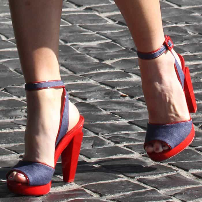 Olivia Munn wearing a pair of Christian Louboutin 'Soclo' denim red sandals