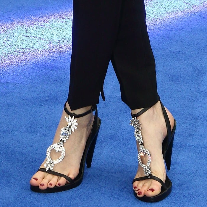 Cara Delevingne showing off her feet and pedicure in bejeweled sandals