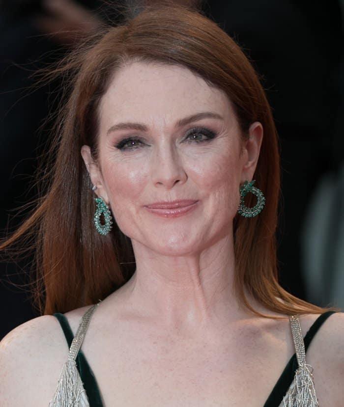 Julianne Moore wearing Chopard emerald earrings at the Venice Film Festival.