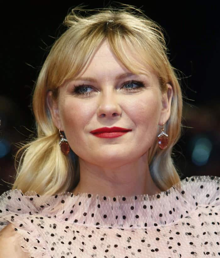 Kirsten Dunst wears vintage-styled Irene Neuwirth earrings at the Venice Film Festival.