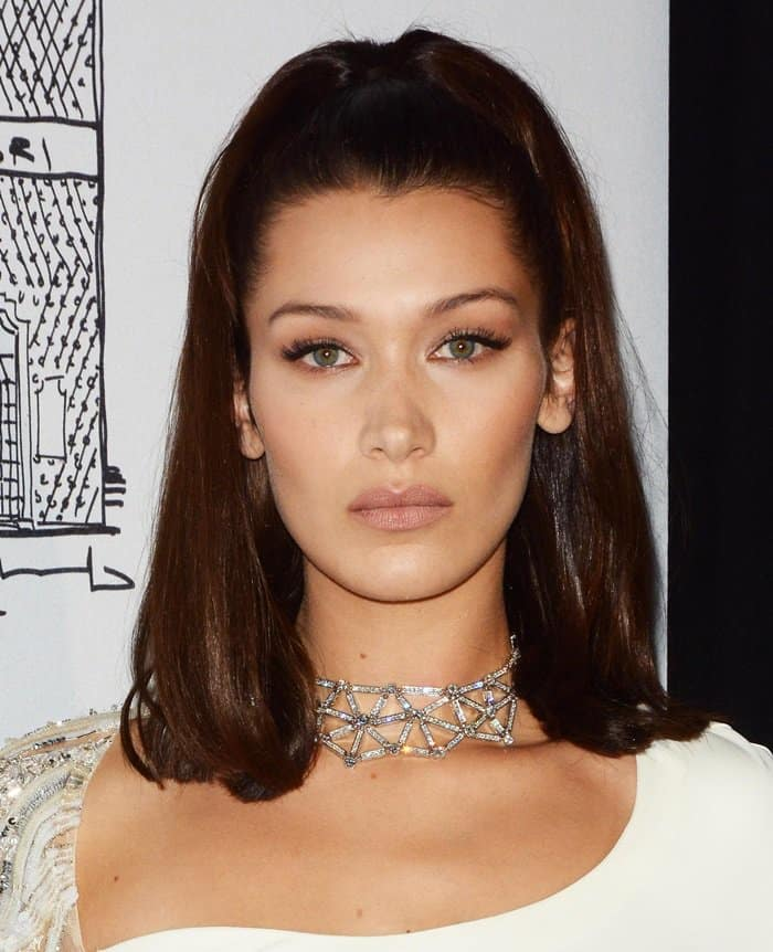 Bella Hadid wears a diamond choker necklace at the Bvlgari flagship store opening in NY.