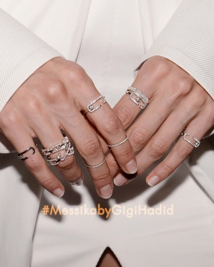 "Image shared by Messika with the caption ""Gigi Hadid playfully mixes and matches her Move Addiction, Move High Addiction and Gatsby rings. #MessikabyGigiHadid#10YearsofMove#DiamondAddiction#messikajewelry#GigiHadid"""