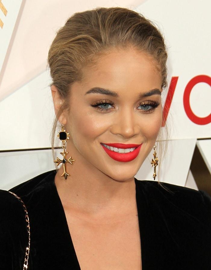 Jasmin Sanders wears cross earrings at the Revolve Awards in California.