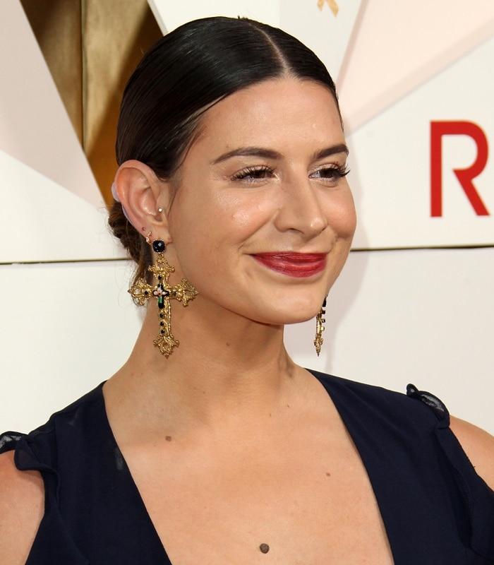 Rachel Zeilic wearing statement earrings at the REVOLVE Awards