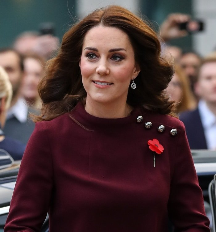 Kate Middleton wearing a flower pin at Place2Be's School Leaders Forum in London.