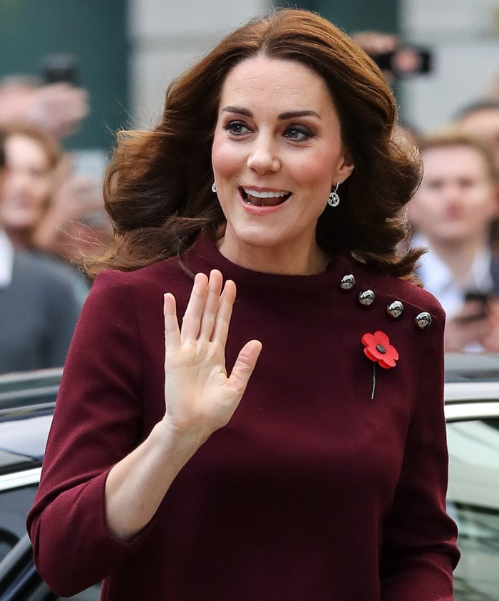 Kate Middleton waving hello to the public at attends Place2Be's School Leaders Forum in London.