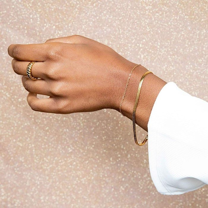 Simple but chic snake chain gold bracelet catches light effortlessly