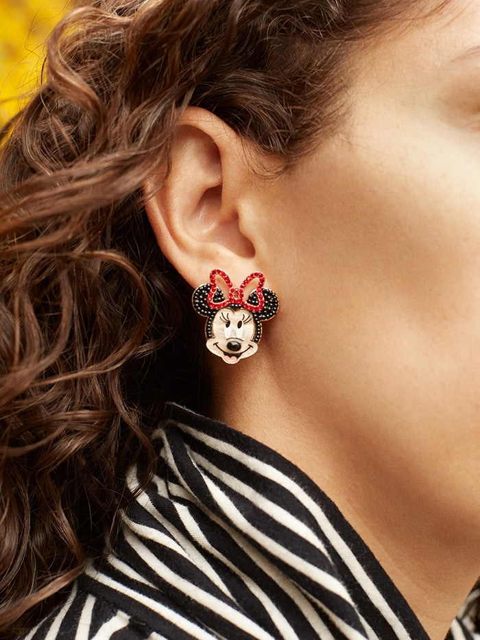 A cute pair of mismatched stud earrings featuring Mickey Mouse and Minnie Mouse