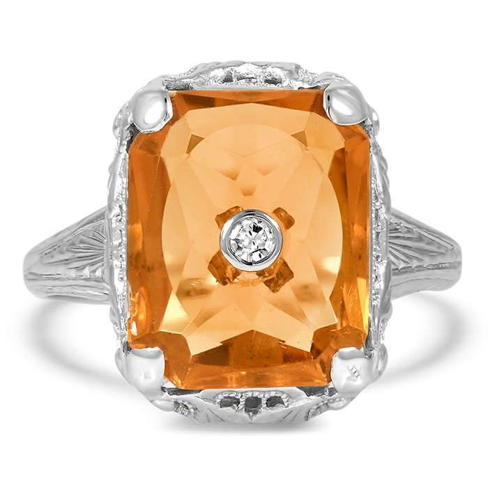 The Vere ring boasts a rectangular citrine with a single-cut diamond accent in the center set in an intricately engraved 14k white gold band
