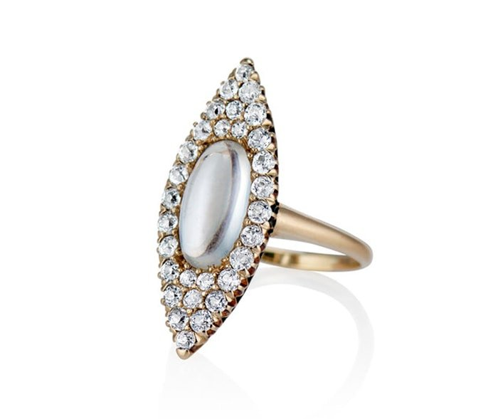 Set in 15k gold metal band, the Moon & Stars ring showcases moonstone and diamond that weigh about 1ct
