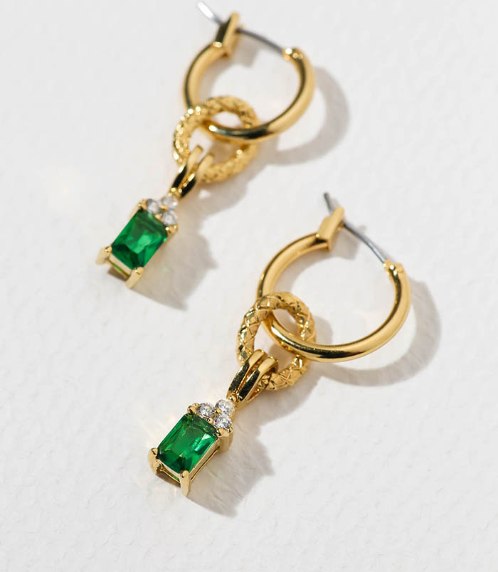Emerald-colored cubic zirconia crowned with triple crystal cubic zirconia hangs from 24k gold-plated hoops