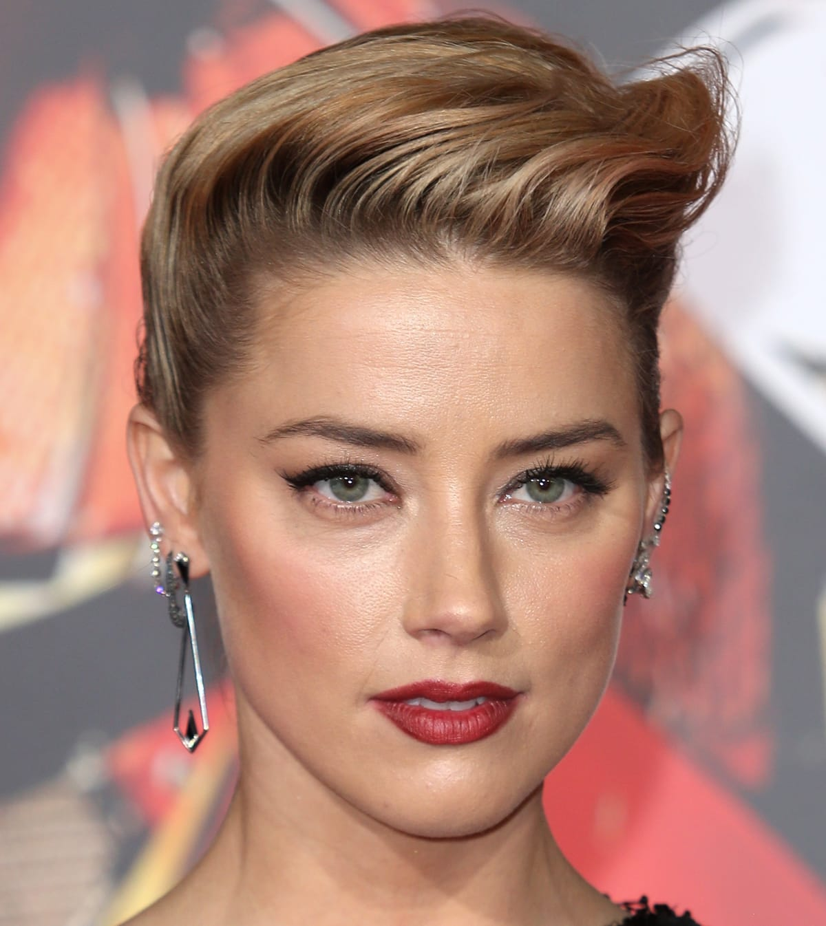 Amber Heard wears Eva Fehren earrings at the premiere of Warner Bros. Pictures' 'Justice League'