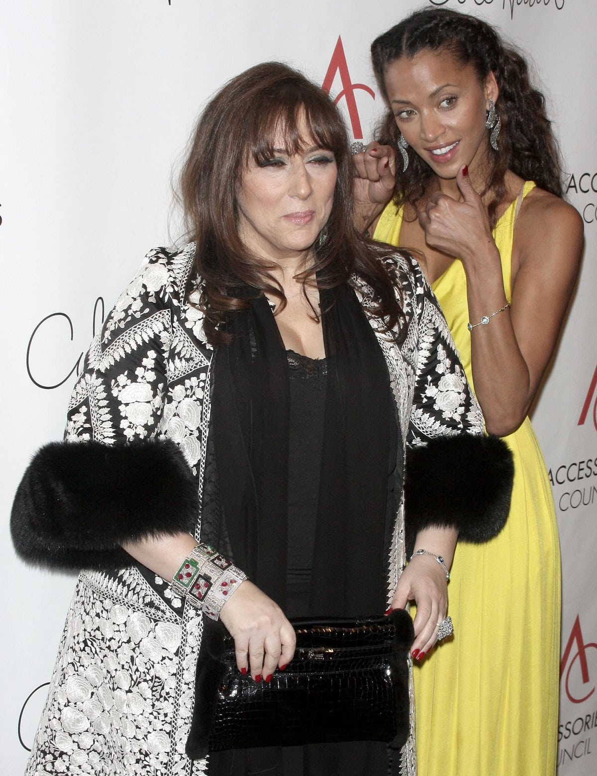 American bespoke high jewelry designer Lorraine Schwartz (L) and French model Noémie Lenoir