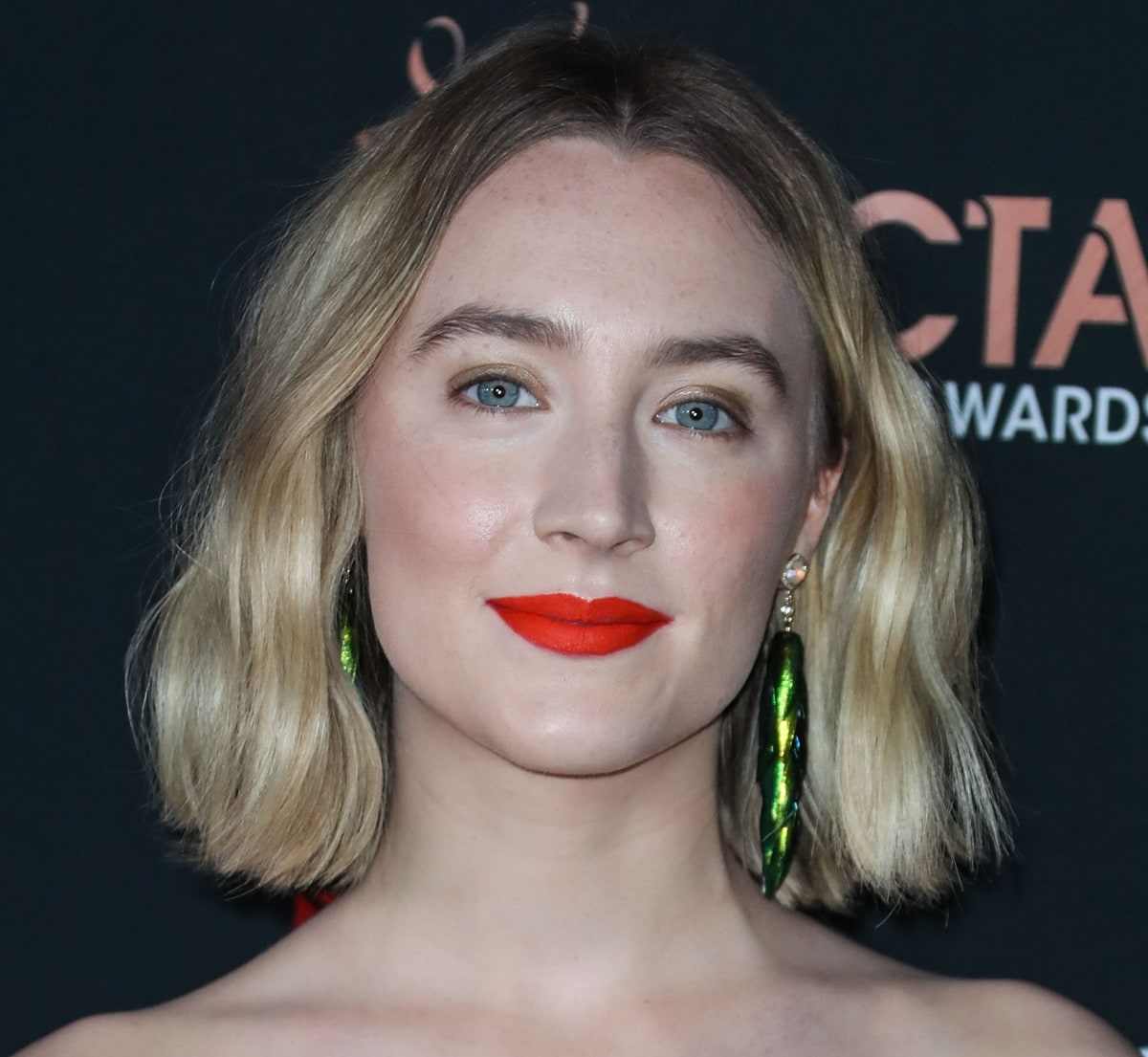Saoirse Ronan wearing Jacquie Aiche pave diamond opal and beetle wing earrings
