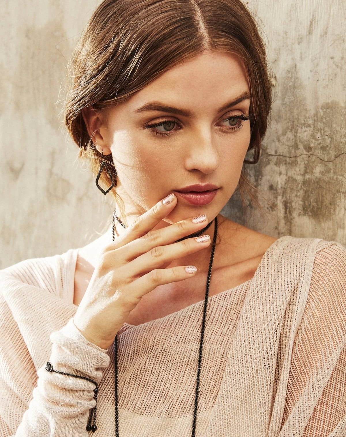 Intricately textured with leafy indentations, these lovely drop earrings from American jewelry designer Kendra Scott feature a subtly curved silhouette that finishes your look with understated femininity