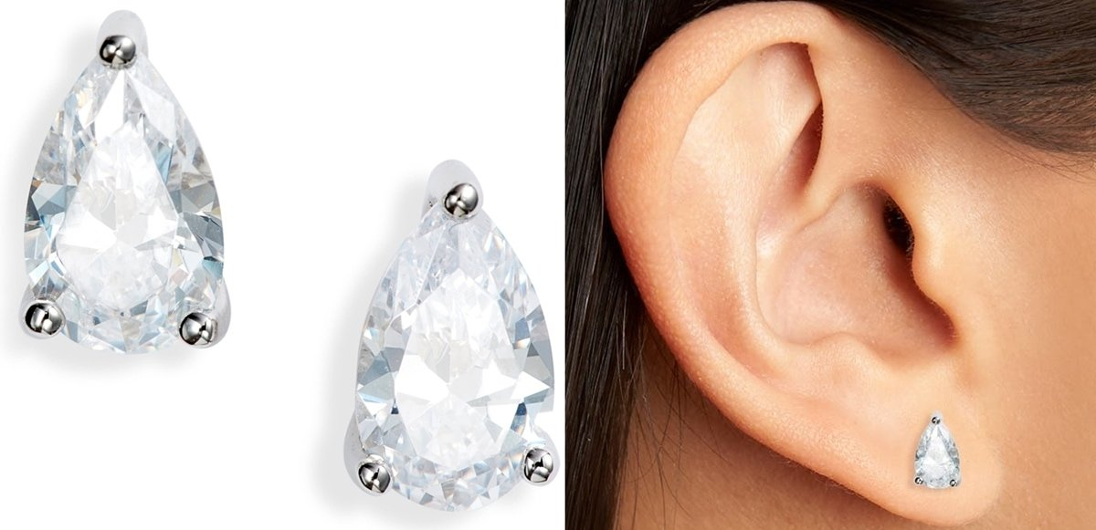 Timeless pear-shaped studs feature sparkling cubic zirconia stones secured by triple-prong settings