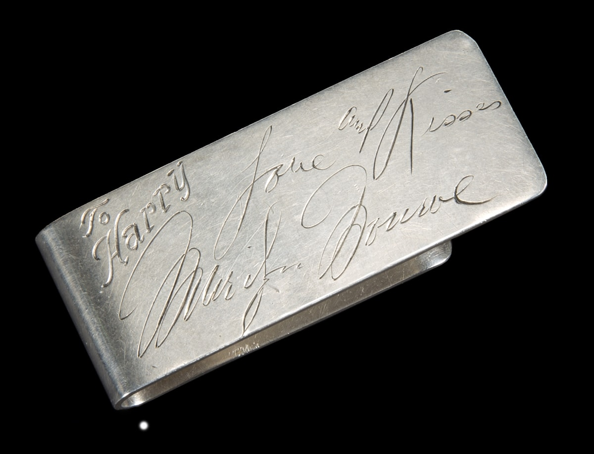 """A sterling silver money clip, engraved on the front """"To Harry"""" with the engraved signature in Monroe's hand """"Love and Kisses / Marilyn Monroe"""